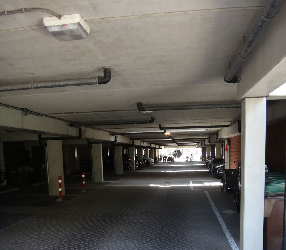 The garages underneath the homes. The length of each block of homes is determined by the maximum length over which it is possible to naturally ventilate the car park underneath, avoiding costly mechanical ventilation systems