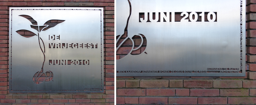 A plaque near the entrance lists the names of all the original group members