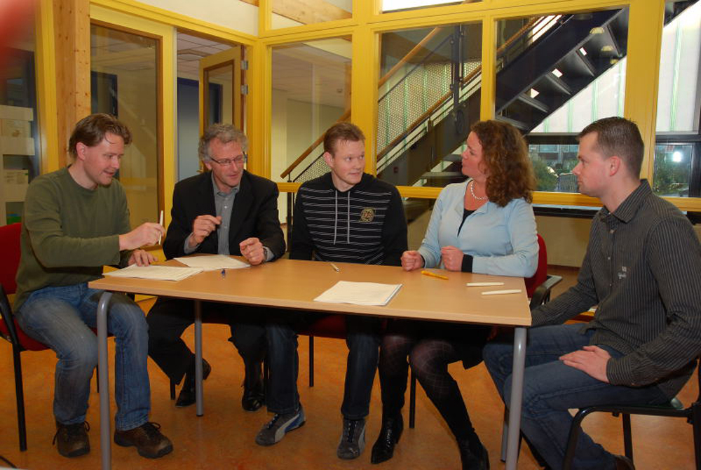 The signing of the contract between the group, the local council and the housing association